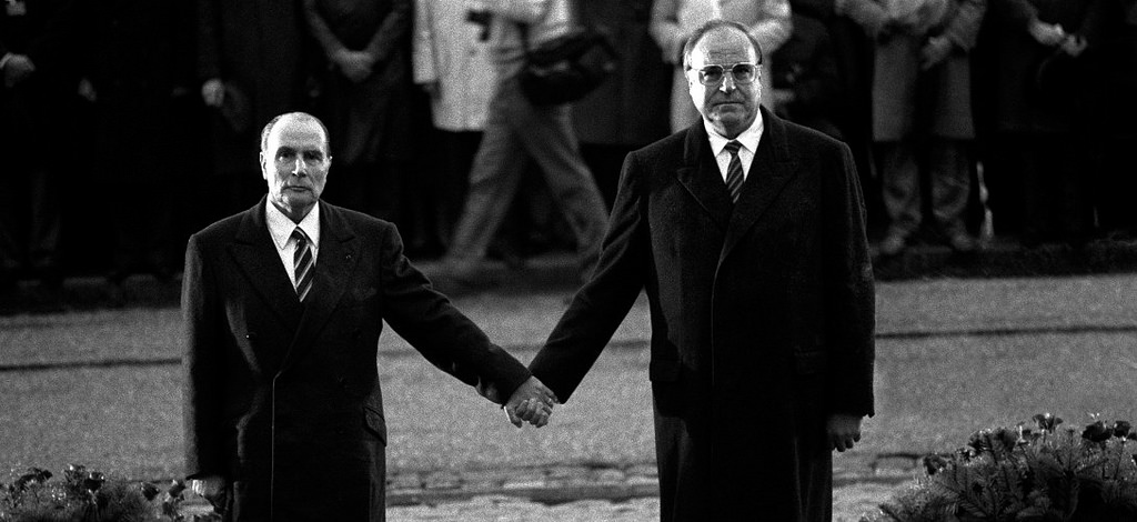 Mitterrand and Kohl hand in hand in front of the ossuary in Verdun