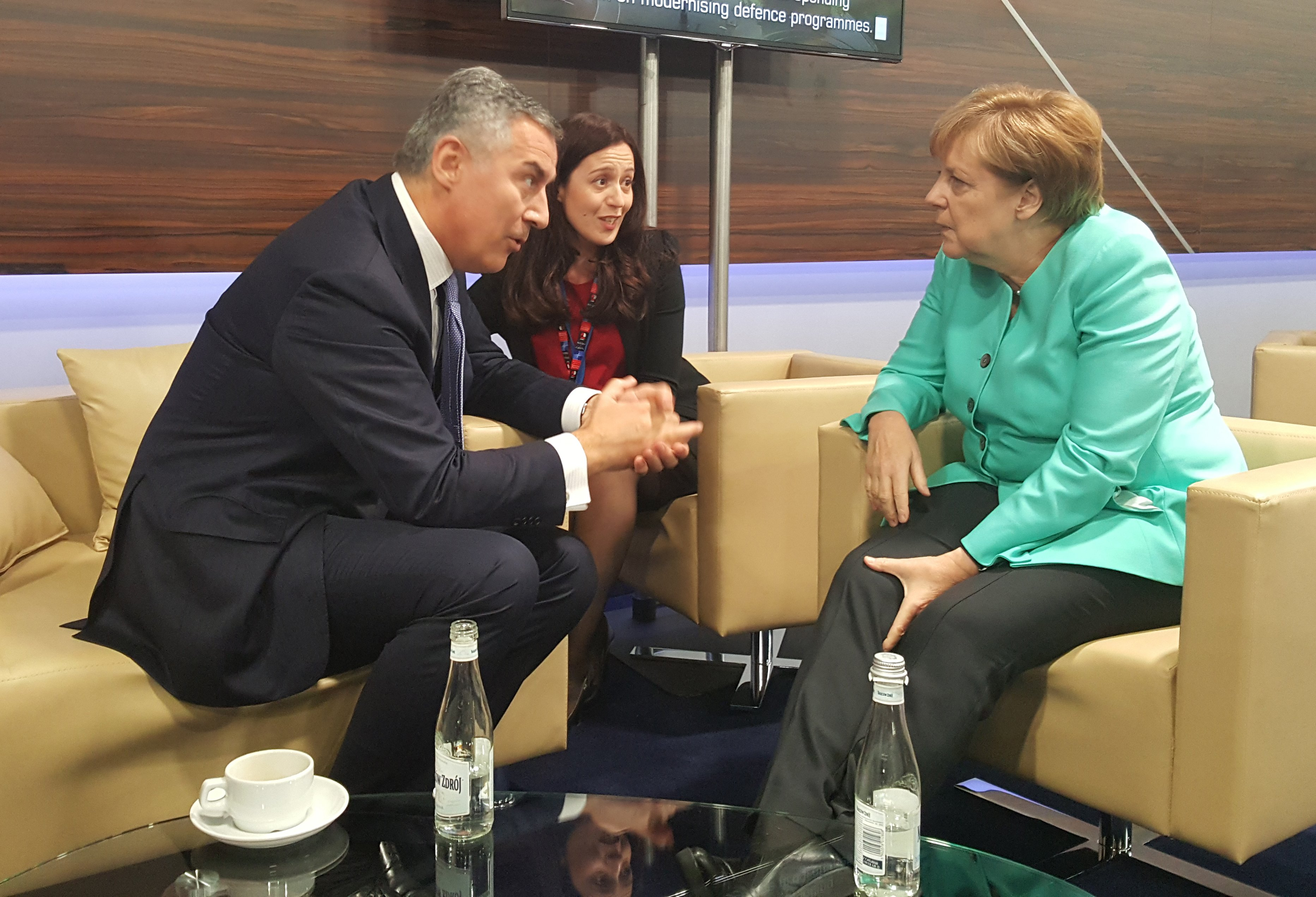 Đukanović meets Merkel during the NATO Summit in Warsaw 2016.