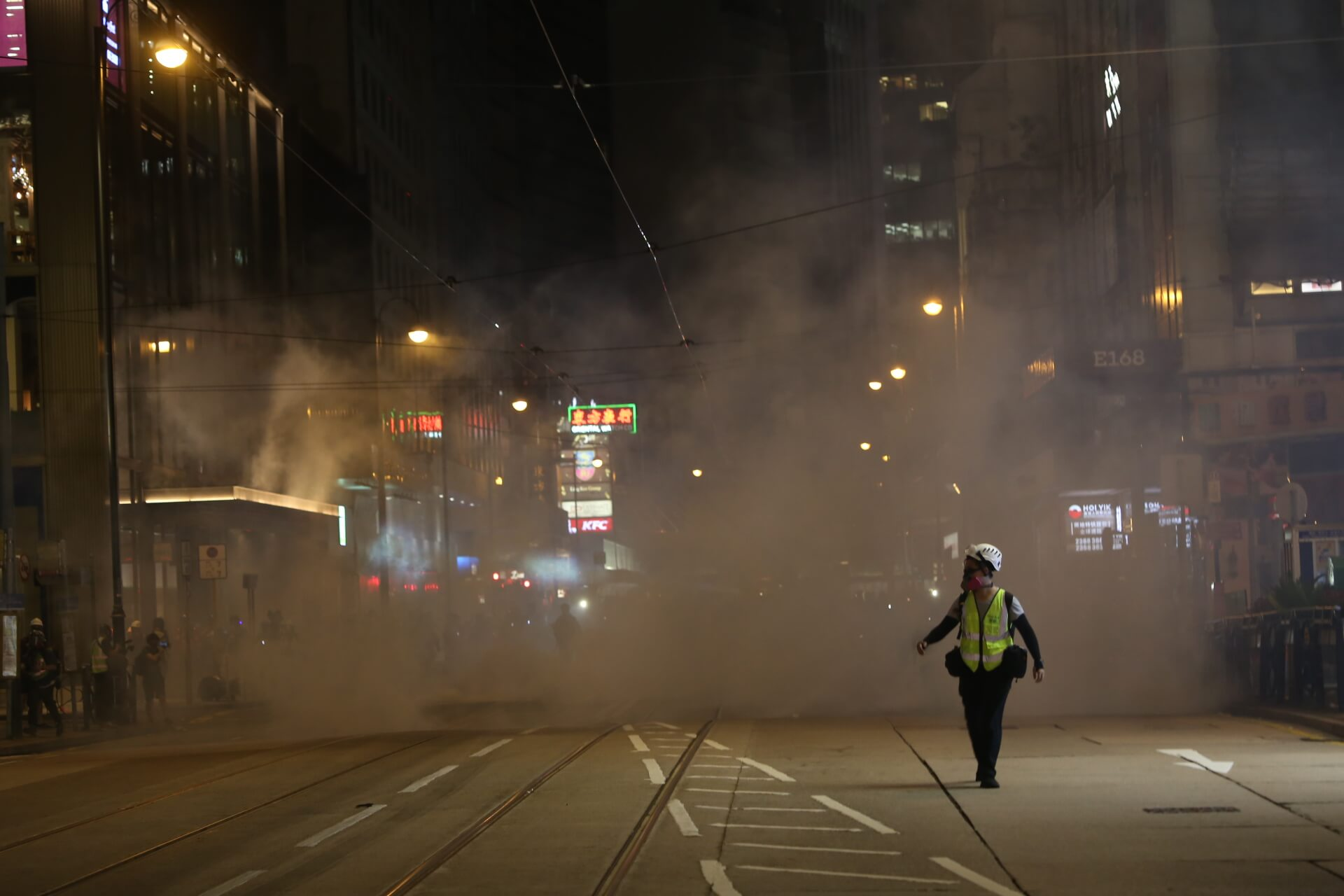 A journalist runs away from tear gas fired on the streets near Lan Kwai Fong, a popular nightlife district in Hong Kong. © Katherine Cheng / Flickr