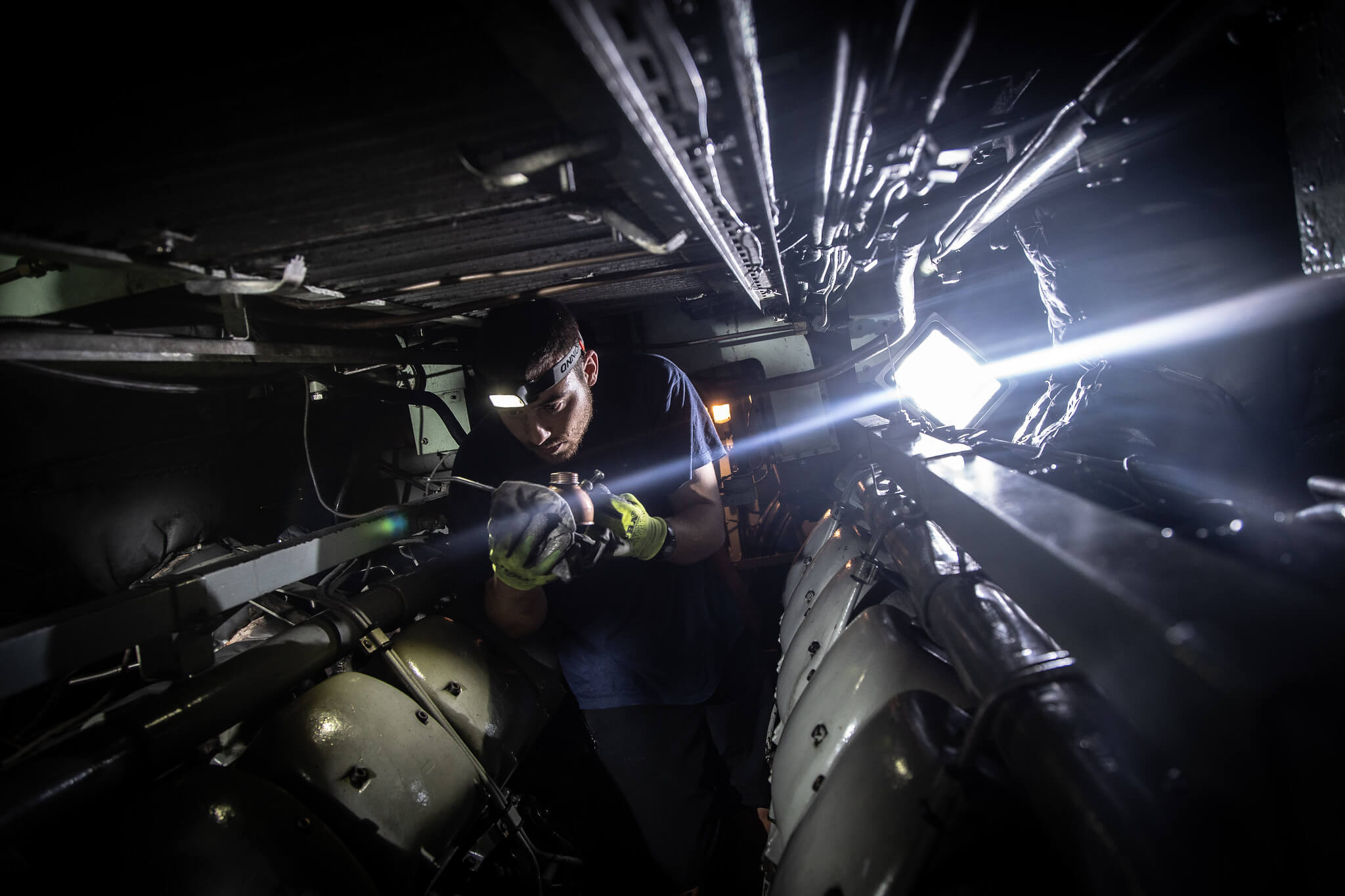 A seaman works in the engine room of a Spanish submarine during the NATO exercise Dynamic Mariner, 2019. © NATO / Flickr