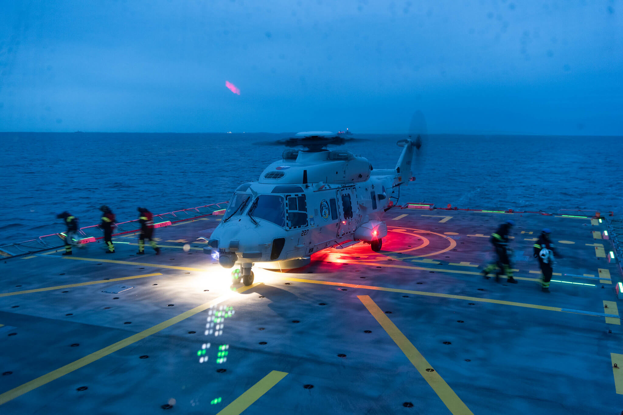 Boxhoorn - A Dutch Navy NH-90 helicopter lands on SNMG1 HDMS Esbern Snare in order to perform a Rotors Running Refuelling (RRR) during Trident Juncture Exercise in 2018. NATO