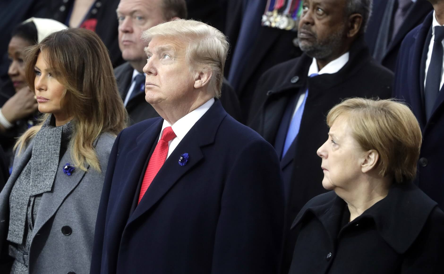 Frohlich-President of the United States of America Donald Trump and First Lady Melania Trump with Federal Chancellor of Germany Angela Merkel at the commemorative ceremony marking the centenary of Armistice Day in November 2018. Wikimedia