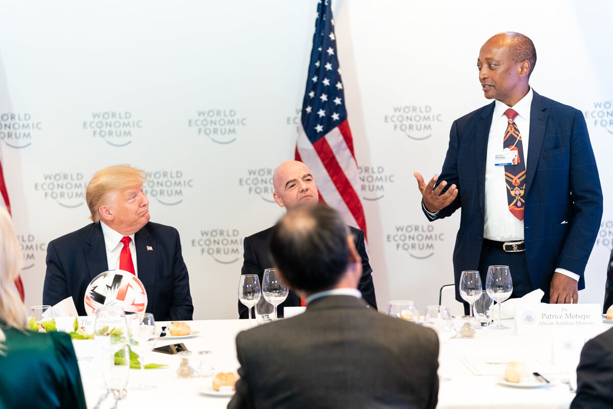 Links - President Donald J. Trump listens African Rainbow Minerals Founder and Executive Chairman Patrice Motsepe at Davos in January 2020. White House Photo
