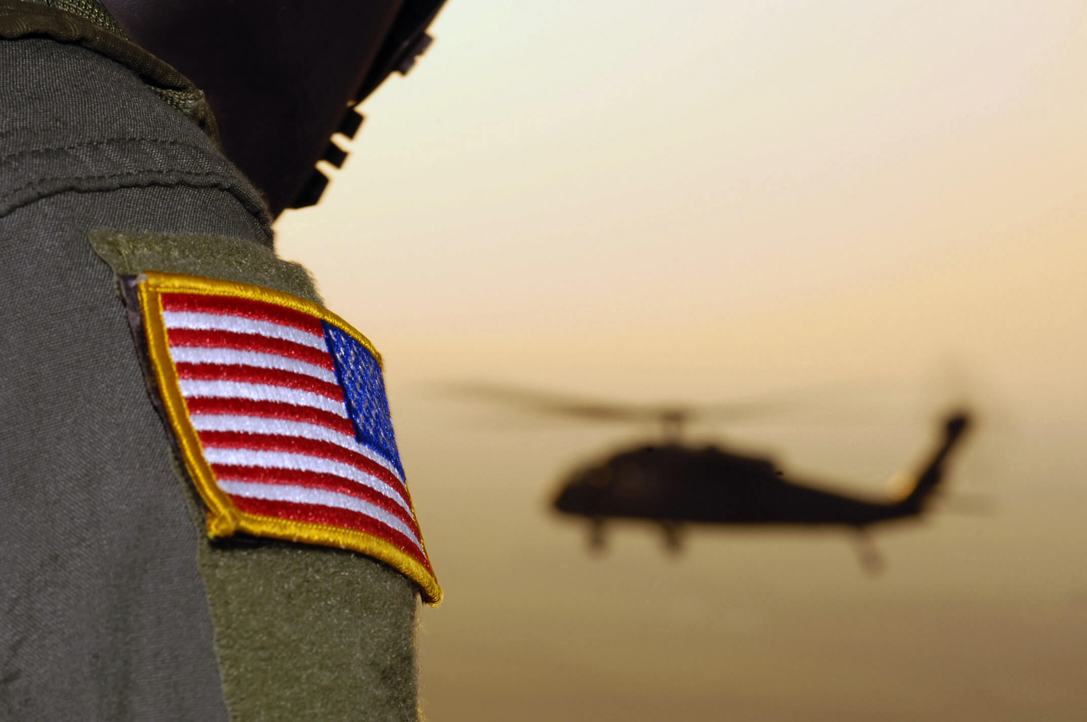 Close-up of a US Flag patch as a US Army Black Hawk helicopter returns to Ellington Field, Texas. © MCWNIMC, US Army - Flickr