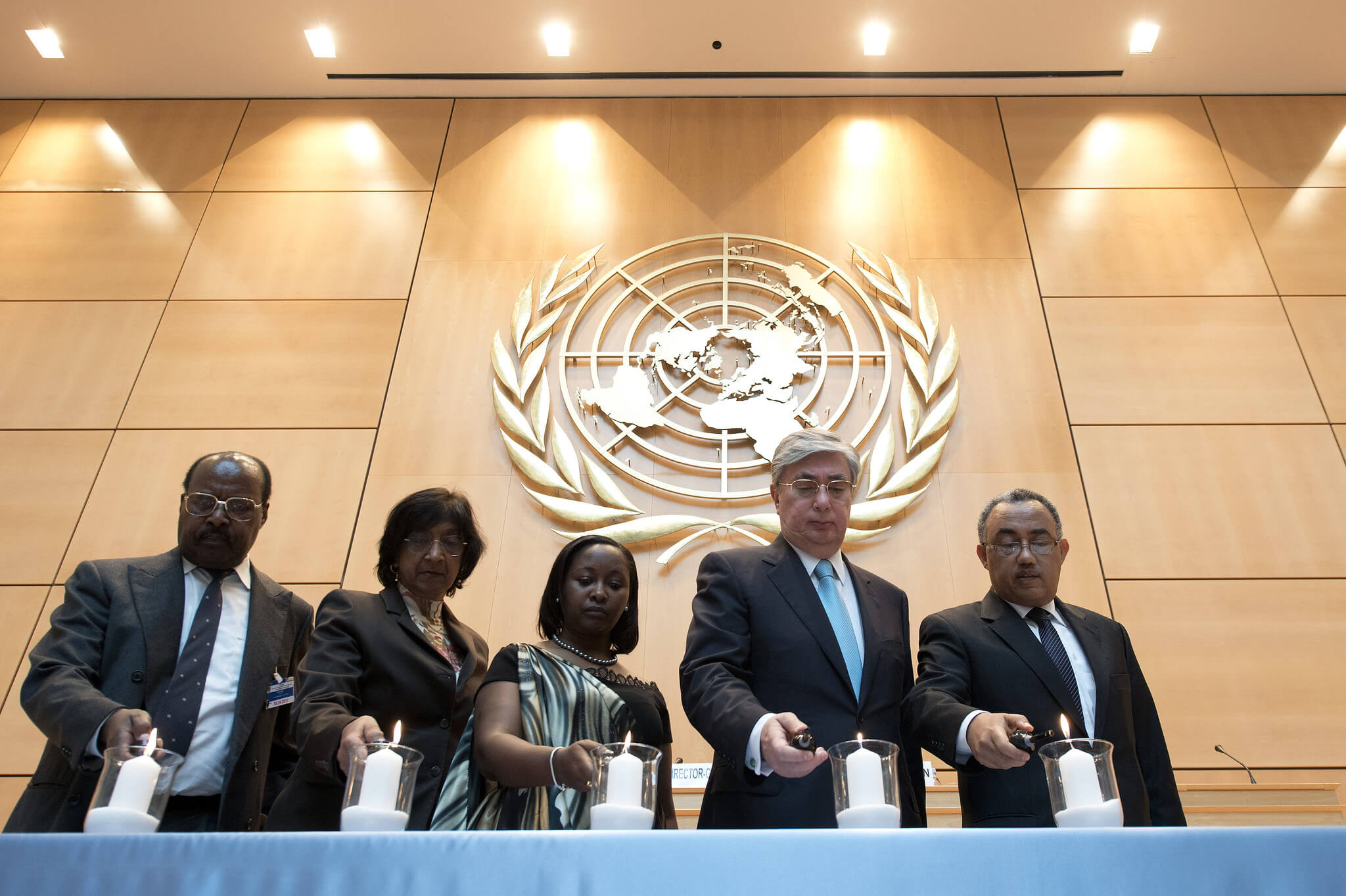 Officials light memorial candles during an event held at the UN Office in Geneva (UNOG) in April 2013 to mark the International Day of Reflection on the 1994 Genocide in Rwanda - United Nations Photo