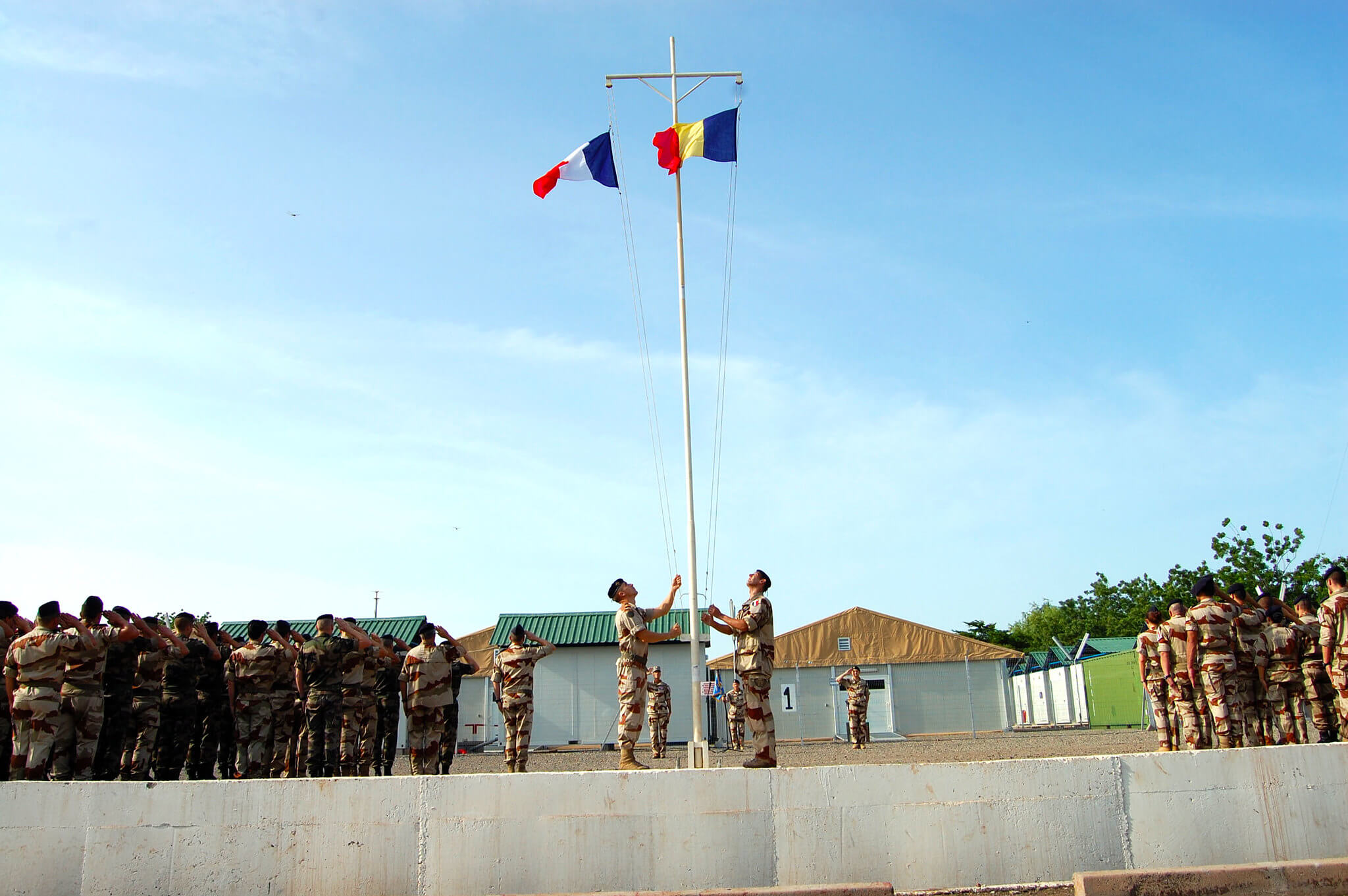 French and Chad military participate in a flag ceremony to commemorate the launch of Operation Barkhane, an anti-terrorist operation in Africa's Sahel region beginning in July 2014. © US Army Africa