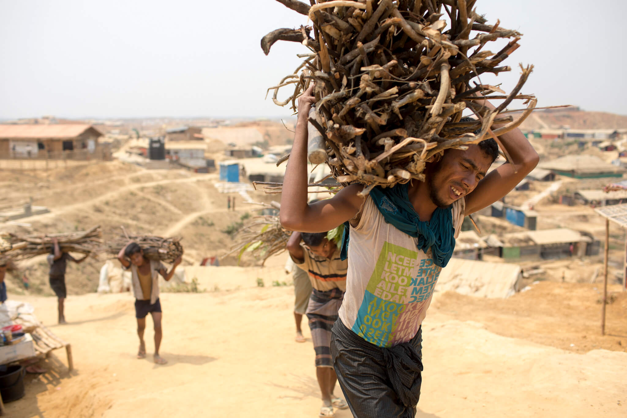 Rohingya Refugees Carry Wood to Kutupalong Refugee Camp Bangladesh