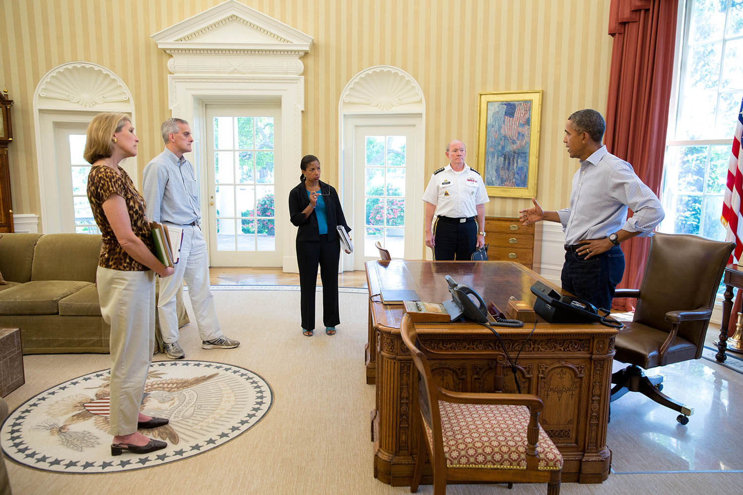 President Barack Obama discusses the situation in Syria with senior advisors in the Oval Office with Karen Donfried on the left. Source: Obama White House / Flickr