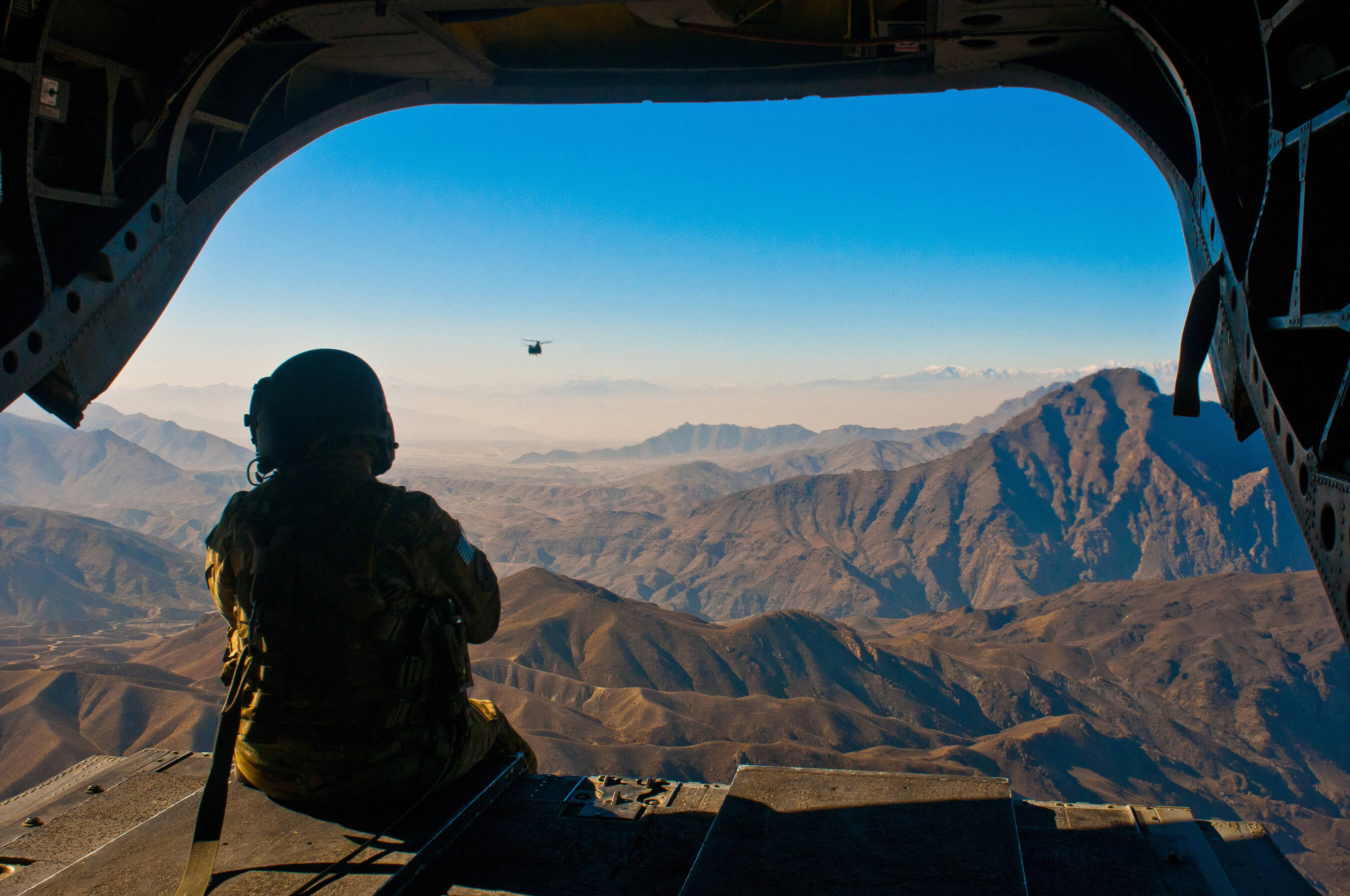 The Afghanistan landscape out the back door of a Chinook helicopter in 2010.