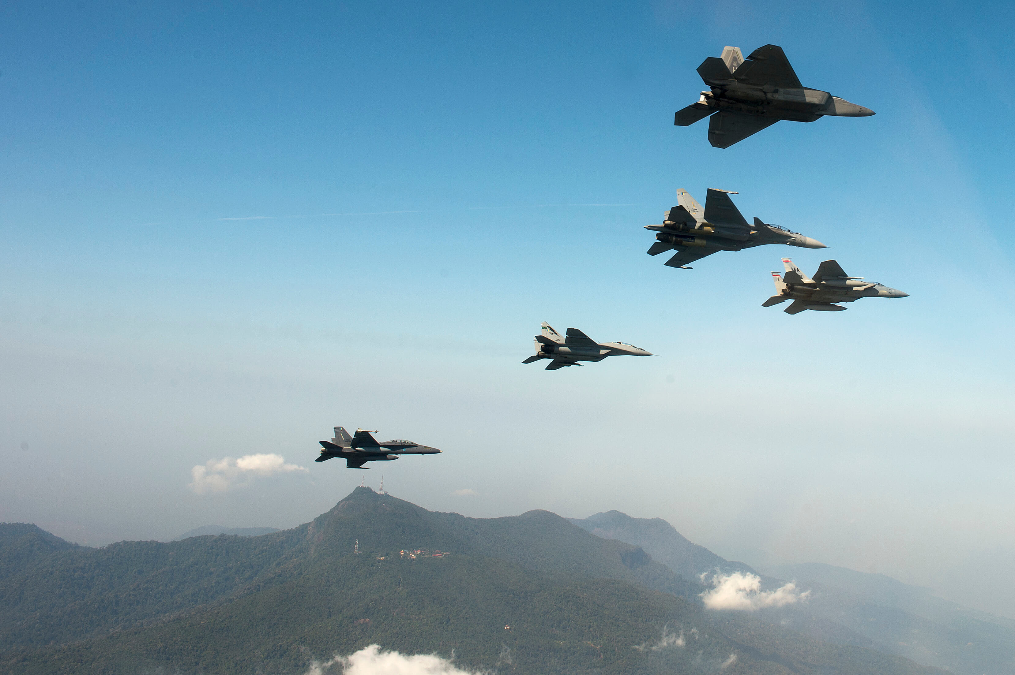 F-15 and F-22 aircraft during a training exercise in Malaysia, June 2014. © Massechusetts National Guard/Flickr