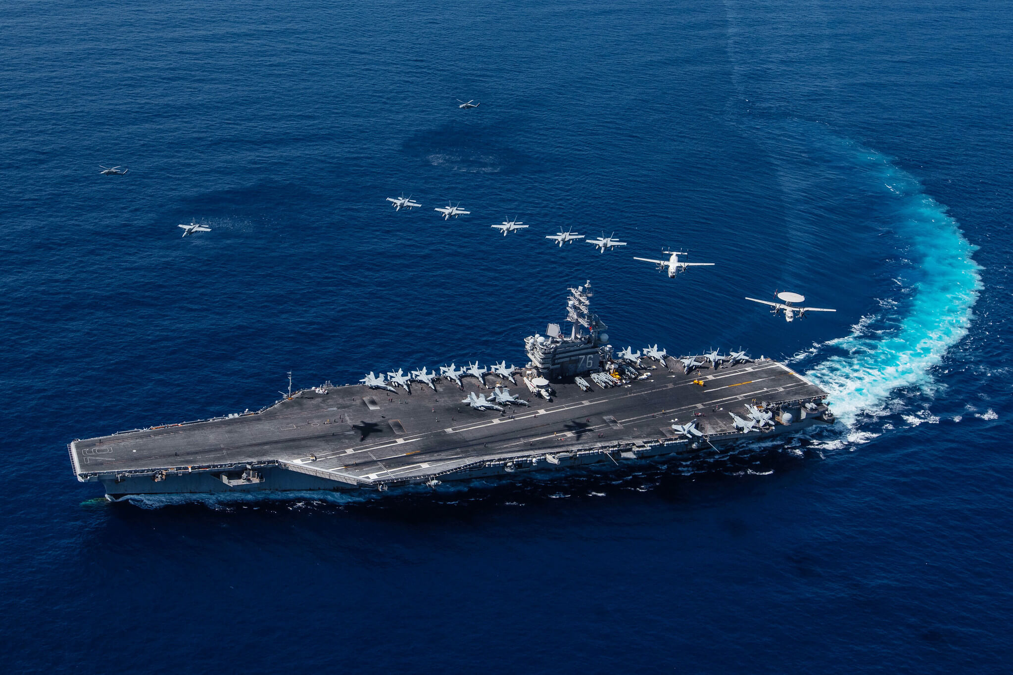 Yinhong - Multiple aircraft 5 fly in formation over the Navy's forward-deployed aircraft carrier USS Ronald Reagan in the South China Sea in October 2019. U.S. Pacific Fleet